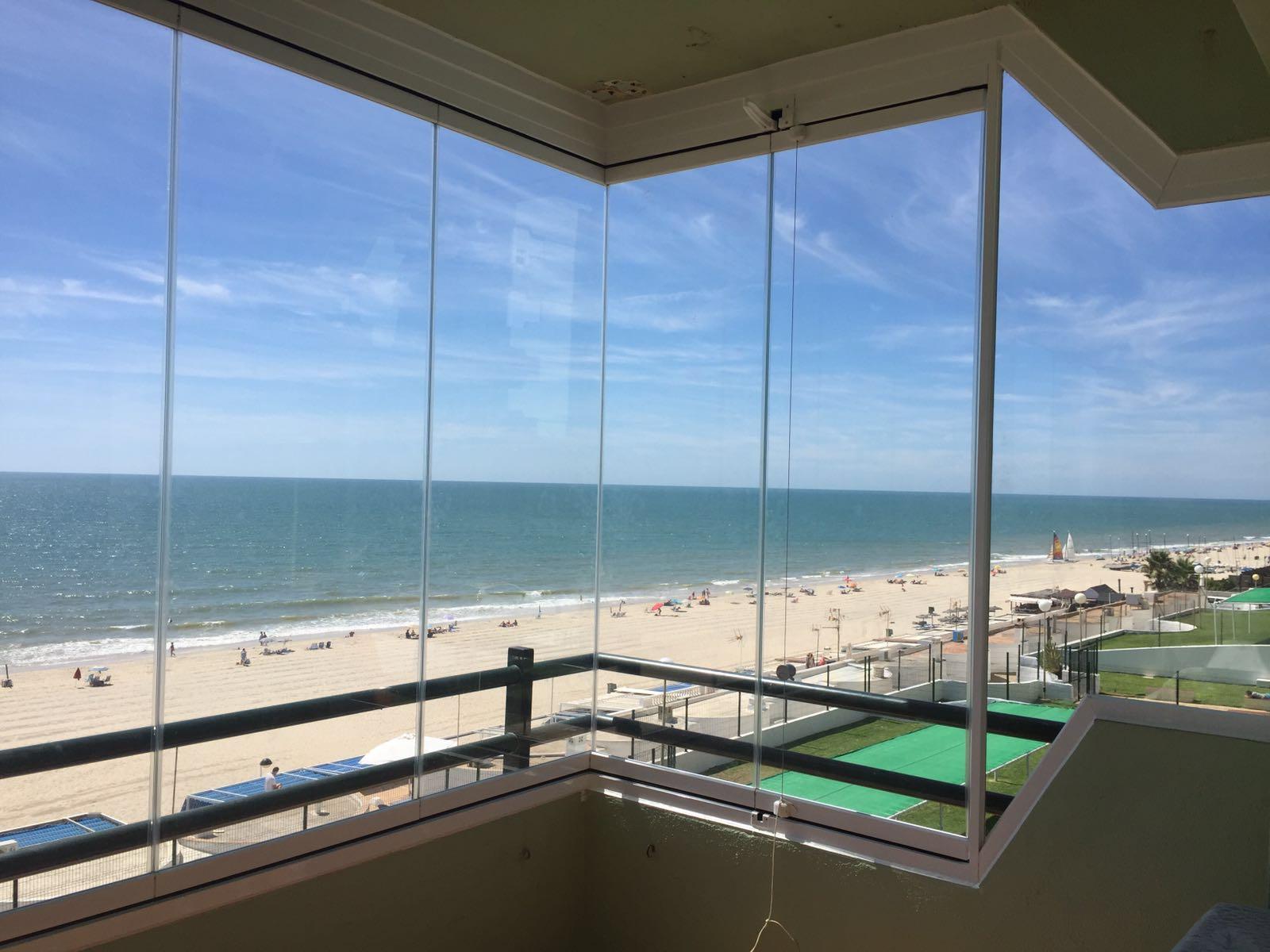 cortina vidrio cerramiento apartamento playa cristaleria y aluminios guzman